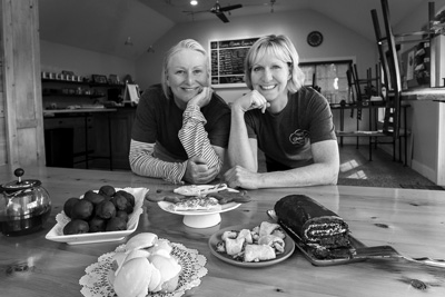 MaryAnna O'Donnell and Jeanne Daley show off some of the baked goods they sell at Saratoga Gluten Free Goods, their year-old bakery and cafe in Schuylerville. Joan K. Lentini photo