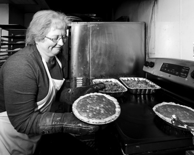 Shelley Smith says she learned the finer points of pie making from her husband's grandmother. The family orchard's bake shop now regularly produces nearly two dozen pie varieties. Joan K. Lentini photo