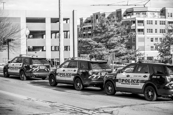 Police cars line the street opposite the Saratoga Springs Police Department headquarters at City Hall. photo by Joan K. Lentini